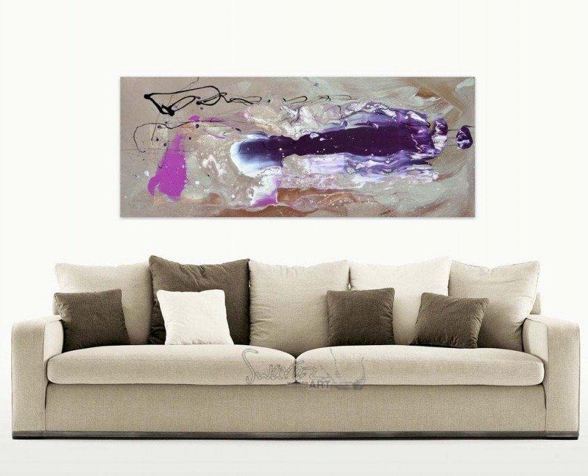 beige sofa with purple art