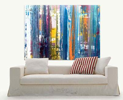 Big-blue-themed-art-behind-a-beige-sofa