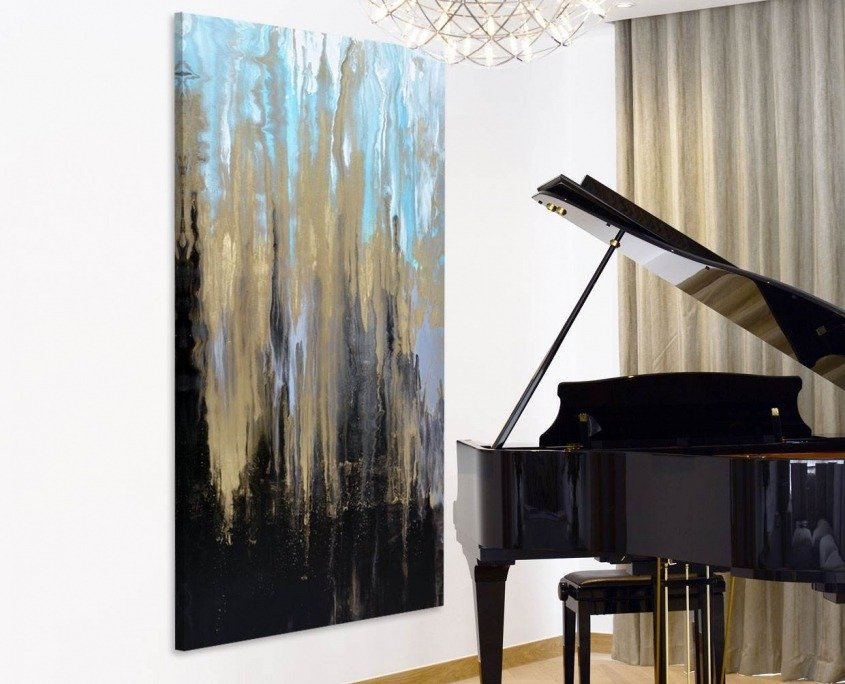 Black and gold art by a piano