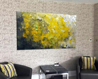 mustard-yellow-abstract-painting-and-two-black-chairs