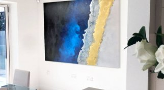 blue and gold art in a kitchen
