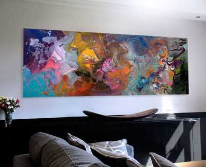 Rainbow-coloured-art-above-a-sofa