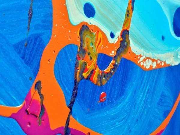 details of orange and blue paint on canvas