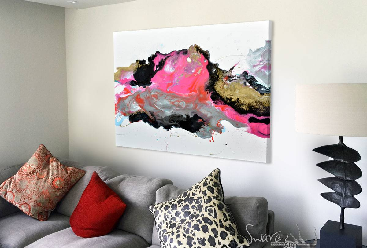 gold and pink canvas art on wall