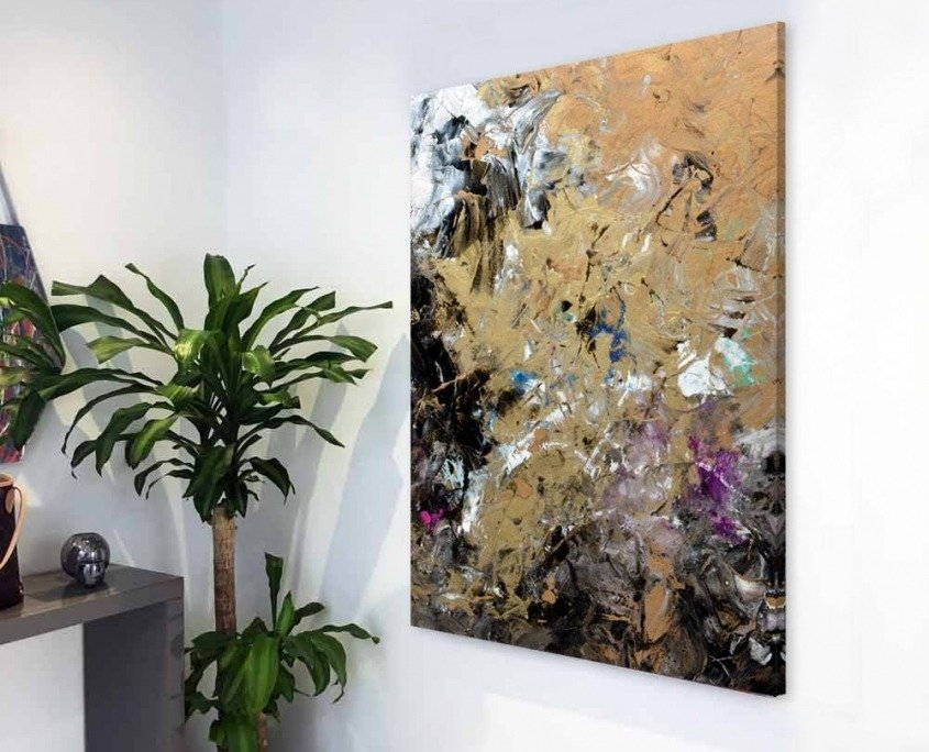 small black and gold abstract painting hanging in hallway