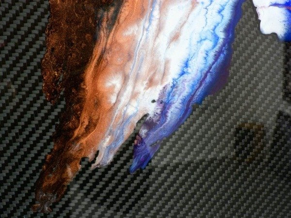 layers of poured resin on art