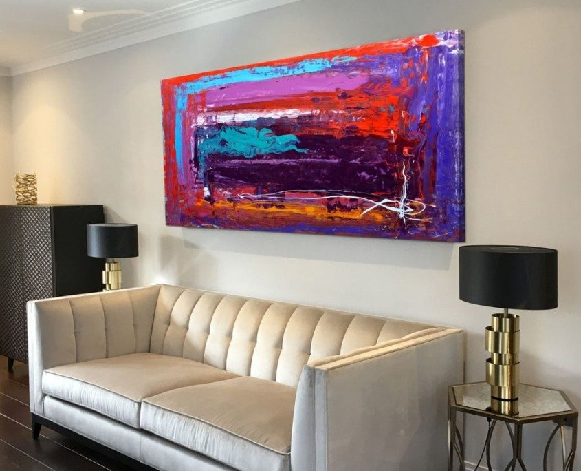gold sofa with red purple painting