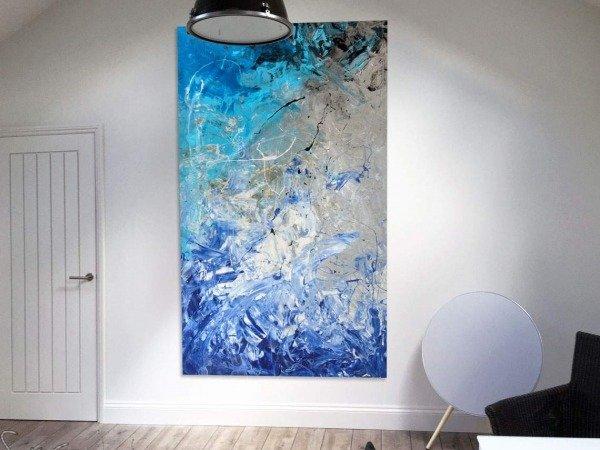 big blue original art on a wall