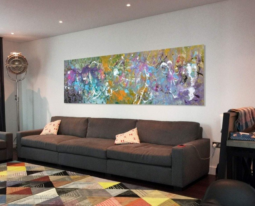 long piece of art behind sofa