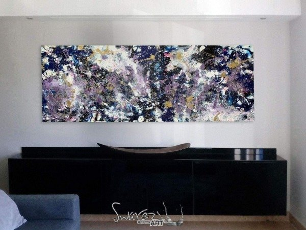 black and purple art above console table
