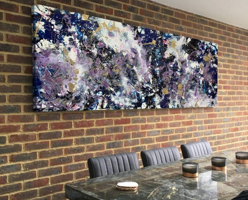purple and white abstract painting on brick wall