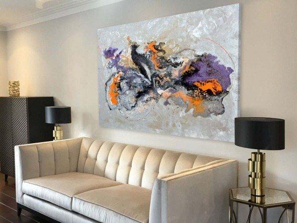 orange purple painting above sofa