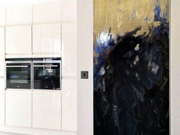 blue and gold abstract painting in a kitchen