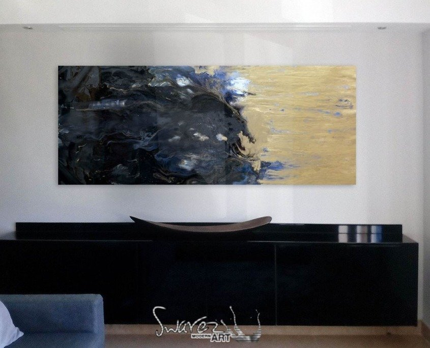 gold and blue art on a wall