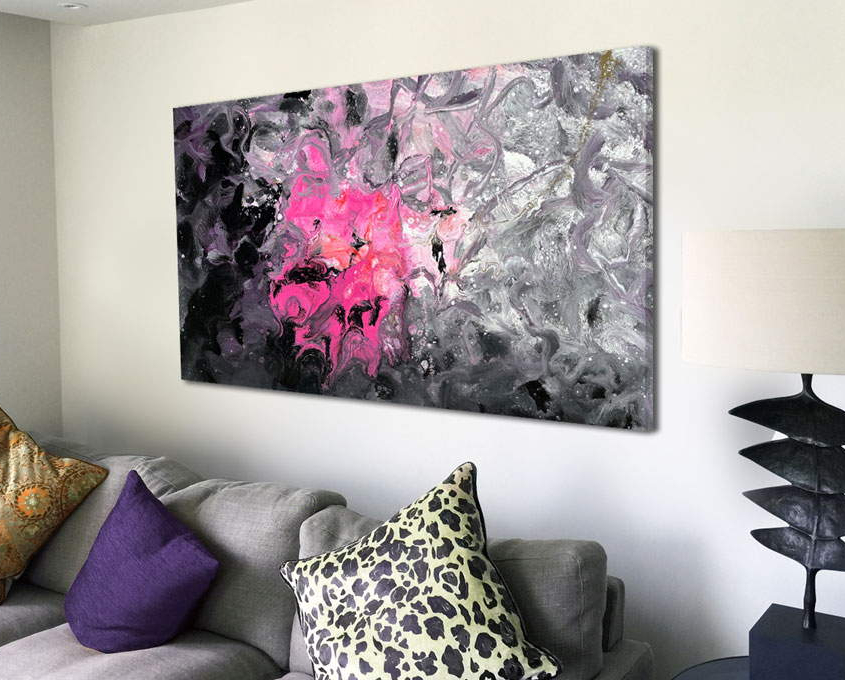 pink and black painting above sof